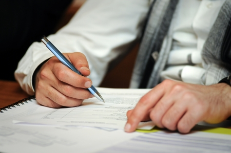 Man Filling Forms photo
