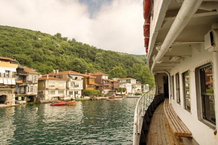 Passenger boat approaching Anadolu Kavagi; a touristic fishing town in Istanbul, Turkey