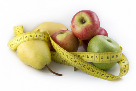 Measuring Tape Wrapped Around Apples And Pears photo