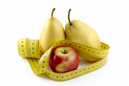 Measuring Tape Wrapped Around Apple And Pears photo
