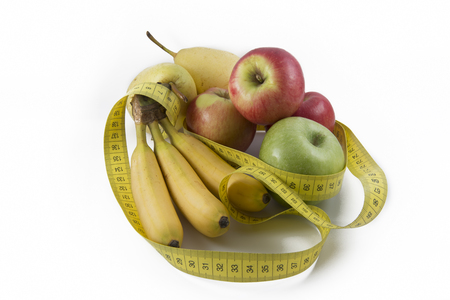 Measuring Tape Wrapped Around Several Fresh Fruits photo
