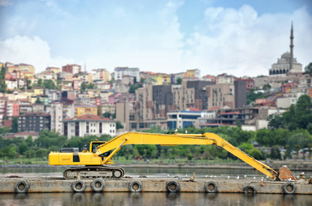 islet: Excavator Parked On An Islet in Istanbul, Turkey Stock Photo