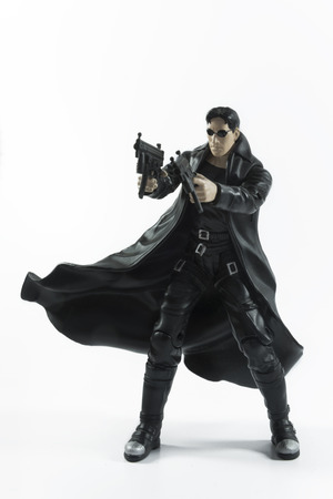 action figure: Istanbul,Turkey - January 12,2015: Action figure of Neo (Keanu Reeves) from movie The Matrix, isolated on white background.