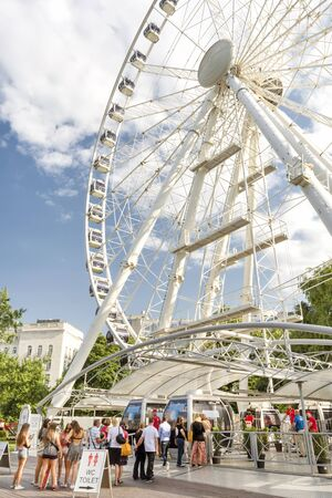 ferriswheel: People Waiting In Line For Szigets Eye, Budapest, Hungary