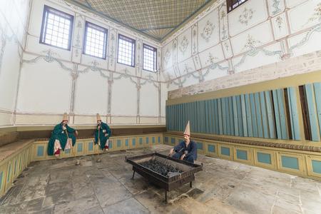 interrior: Wax Sculptures Of A Braided Guards Heating Up Brazier And Smoking Pipes Zuluflu Baltaci Inside Topkapi Palace, Istanbul, Turkey