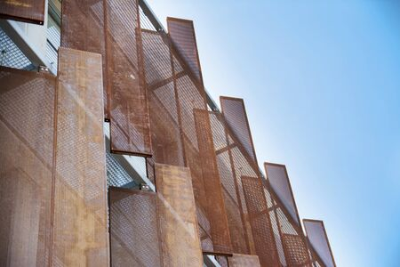 outworn: Artistic Metal Panels On Building Exterior