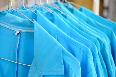 Blue Collar Jackets Hanging On A Line