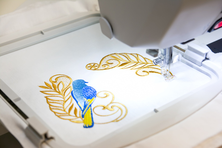 Computer Aided Embroidery Machine At Work Stock Photo