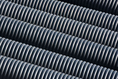 plastic conduit: Black Plastic Pipes Stock Photo