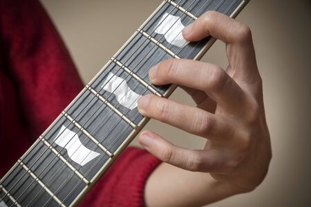 blues music: Fingers On Electric Guitar Fretboard Stock Photo