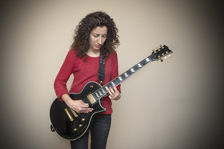 Woman Playing Electric Guitar Stock Photo