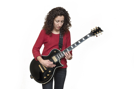 Woman Playing Electric Guitar Isolated On White Background