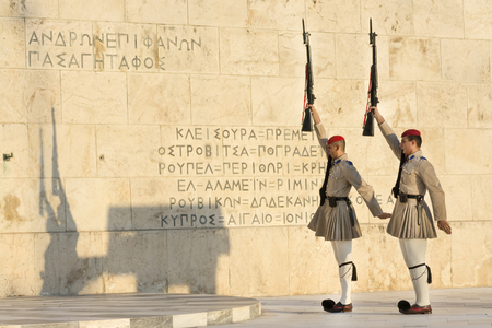elite: Evzones, the Greek an elite ceremonial unit that guards the Tomb of the Unknown Soldier, changing guard posts in front of the Presidential Mansion. Athens, Greece. Editorial