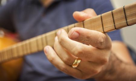 saz: Closeup Shot Of A Man Playing Baglama (Turkish traditional stringed instrument) - Saz