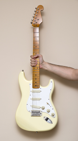 Hand Holding White Vintage Electric Guitar