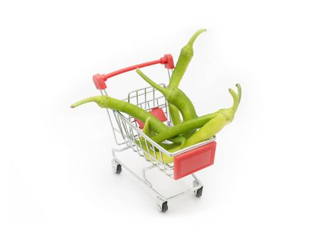 Green Peppers Loaded On A Shopping Cart, Isolated On White Background