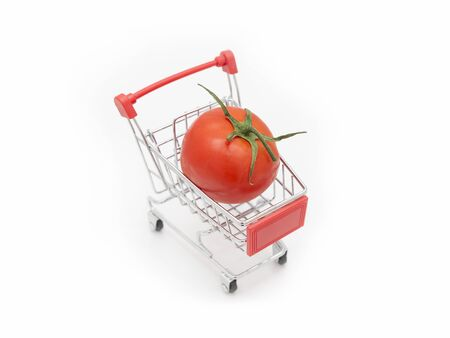 Tomato Loaded On A Shopping Cart, Isolated On White Background Stock Photo