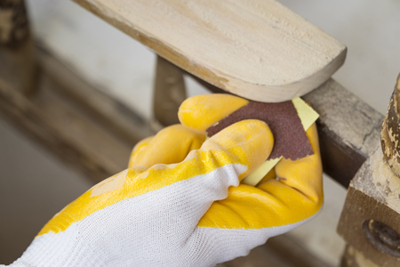 Sanding The Paint Of An Old Furniture