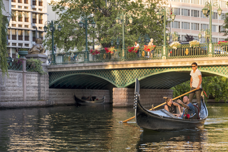 People having a sightseeing tour with gondola on Porsuk river, famous river running across the city centre of Eskisehir, Turkey. Editorial