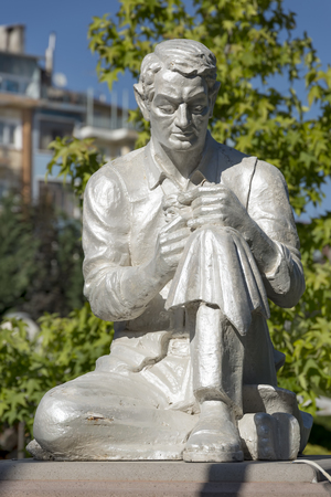 Statue of a man carving smoking pipe from sepiolite (luletasi), famous stone mined at the city of Eskisehir, Turkey.
