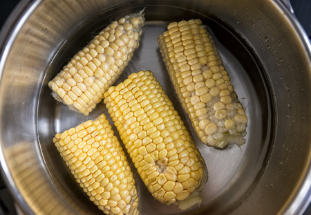 boiling: Boiling Corns Inside Stewpot Stock Photo