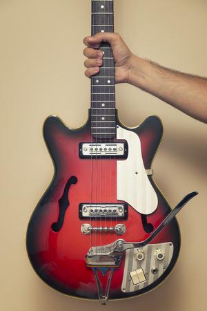 Hand Holding Vintage Electric Guitar