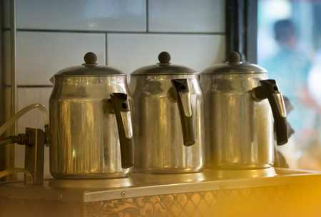 boiling: Boiling Tea Kettles At Restaurant Stock Photo