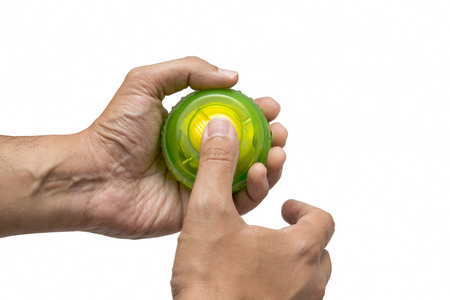 Hands Using Gyroscopic Ball For Exercise, Isolated On White Background Stock Photo
