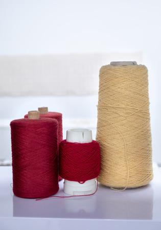 Red And Yellow Yarn Bobbins Stock Photo