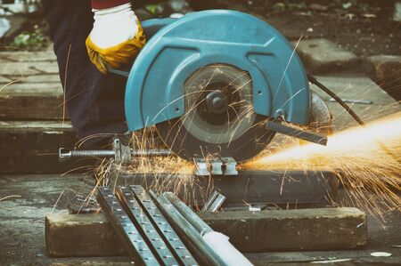 Closeup Shot Of A Worker Cutting Steel With Metal Grinder Stockfoto