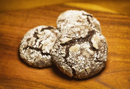 Cracked Chocolate Cookies On A Wooden Surface