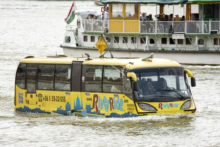 Riverride floating bus cruising at Danube River across Budapest, the capital city of Hungary.