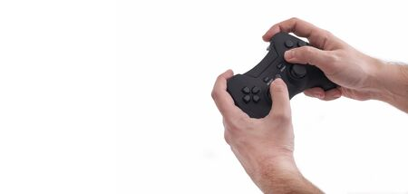 Male Hands Holding A Black Joypad, Isolated On White Background