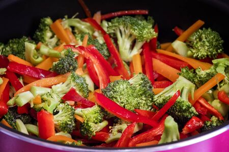 Cooking Broccoli With Thin Sliced Bell Peppers And Carrots