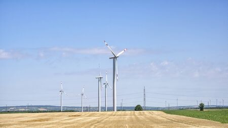 Agricultural Fields With Wind Turbines