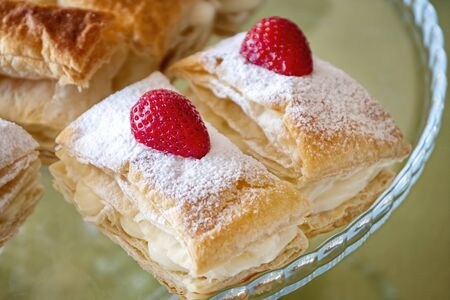 Slices Of Strawberry Cream Puff Pastries Banco de Imagens