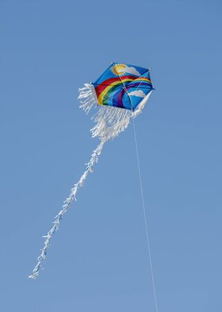 Rainbow Patterned Kite Flying In The Air