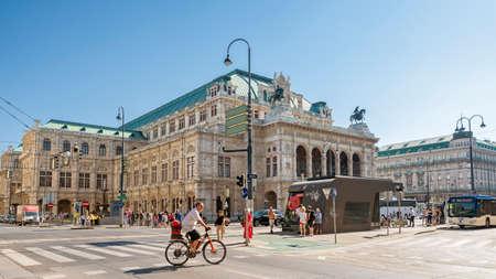 Wide angle view from Opernring, Vienna State Opera at background, an opera house and opera company based in Vienna, Austria. Editorial