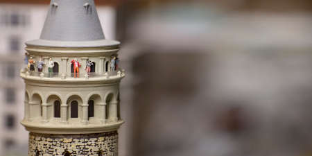 Miniature Galata Tower With Small Sightseeing Tourist Figures