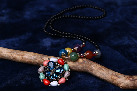 Closeup of necklace on the wood