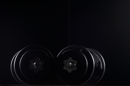 Bodybuilding weights concept on black background. High resolution image concept for bodybuiding or fitness industry.