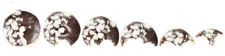 Chocolate glazed doghnut with almond flakes on white background. High resolution image for food industry.
