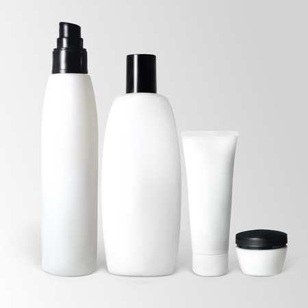 Set of cosmetic products in bottles and tubes. Illustration contains gradient meshes.