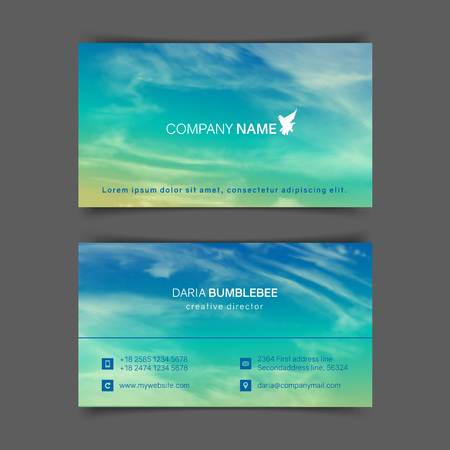 Two-sided horizontal business cards with realistic turquoise-yellow sky and spindrift clouds. The image can be used to design a business card.
