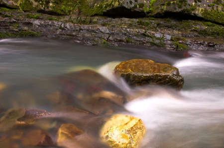 Waterfall stream and two stones photo