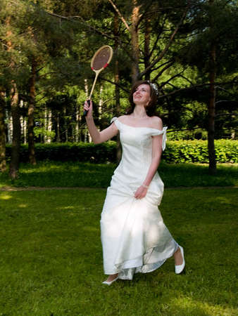 Playing bride on the grass photo