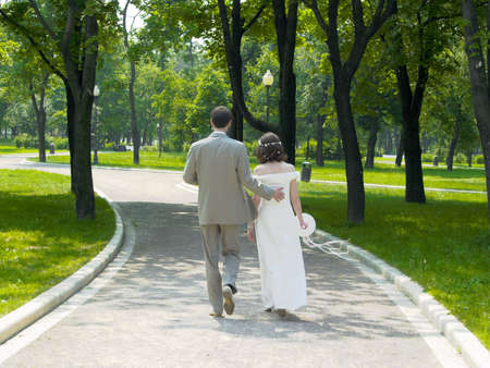 with fondness: Walking couple in the park