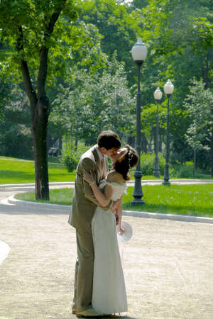 civility: Kissing couple in the park Stock Photo