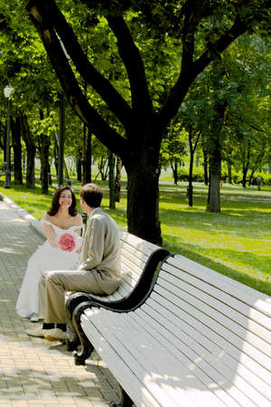 Married couple sitting on the branch photo