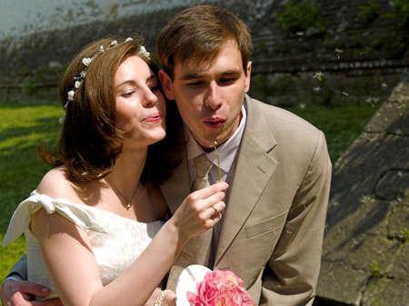 Happy couple and dandelion
